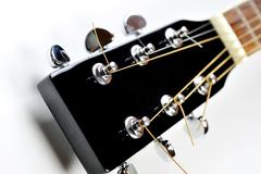 headstock of acoustic guitar - stock photo