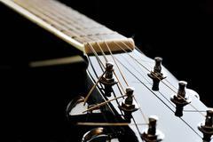 neck of black guitar - stock photo