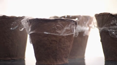 Special seedling pots, covered with polythene Stock Footage