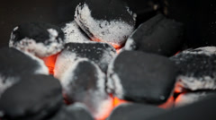 Charcoal glowing and burning  in a barbecue grill - stock footage