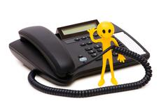 Phone support concept  - smilie and telephone isolated on white - stock photo