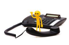Phone support concept  - smilie and receiver isolated on white - stock photo