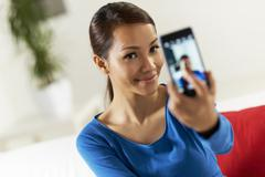 asian girl sharing pictureon social network - stock photo