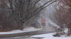 Snow Plow Driving in Snow Storm Stock Footage