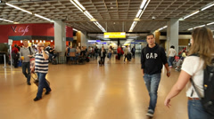 Passengers walk through Guarulhos Airport in Sao Paulo, Brazil Stock Footage