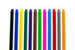 multicolored felt-tip pens on white background - stock photo
