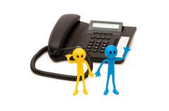 Phone support concept  - smilie and telephone isolated on white Stock Photos