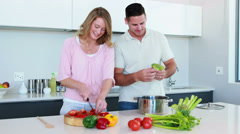 Smiling couple preparing a healthy dinner together Stock Footage
