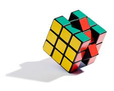 Solving the rubiks cube puzzle Stock Photos