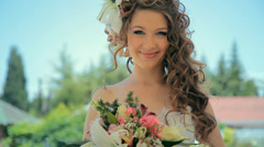 Brides in nature with bouquet - stock footage