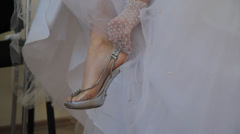 Bride adjusts fastener on shoes Stock Footage
