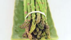 Slow pan over a bunch os asparagus on a plate Stock Footage
