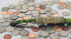 Coins, asparagus and coin wrapper Stock Footage