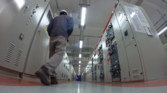 Man working in Electrical substation room - stock footage