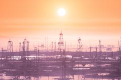 Oil derricks on early morning - Caspian see near Baku - stock photo