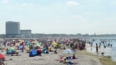 People on the beach in Warnemuende on the Baltic Sea Stock Footage