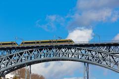 Metro train on the bridge of dom luiz in porto Stock Photos