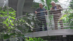 Two old man looking on different species of plants Stock Footage