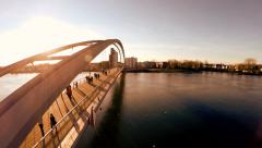 aerial view of bridge at sunset. people crossing bridge. fly over - stock footage