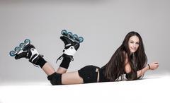 Beautiful woman in roller skates - stock photo