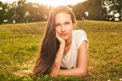 Beautiful woman luing on the grass Stock Photos