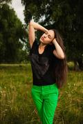 Fashion portrait of a woman with natural long hair posing outdoors - stock photo