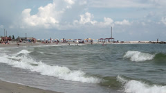 Marine waves in the distance people holiday-makers on the sea of Azov - stock footage