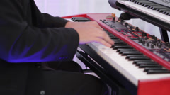Masculine hands playing on a red synthesizer Stock Footage