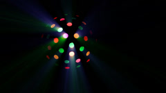 Looping disco spinning light ball with ceiling colorful reflection. Stock Footage