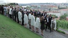 A crowd of people joyful meets the honeymooners Stock Footage