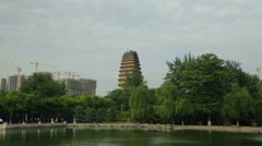 Lesser Wild Goose Pagoda and tower crane of building site Stock Footage