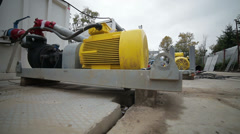 Sliding view of working area with yellow motors and walking worker Stock Footage