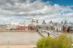 Urban landscape with St. Paul's cathedral and Millennium bridge Stock Photos