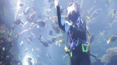 Woman performs Scuba Diving in the Deep Ocean Stock Footage