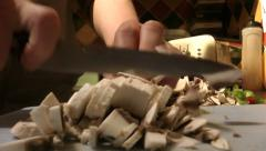 Chef cutting mushrooms finely HD 50 fps Stock Footage