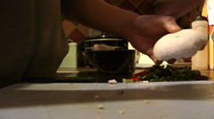 Chef cooking mushrooms HD Stock Footage