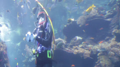 Woman Justified herself with left closer angle in Scuba diving Stock Footage