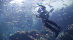Courageous Woman Floating in the sea after her scuba dive - stock footage