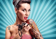 Pin-up girl with tattoos Stock Photos