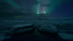 Aurora Borealis (Northern Lights) on Jokulsarlon Lagoon, Iceland timelapse - stock footage