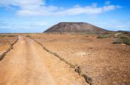 Stock Photo of Trail and volcano on island of Los Lobos in the Canary Islands