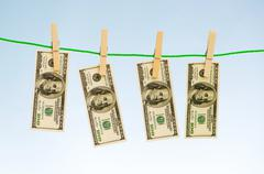 Money laundering concept with dollars on the rope Stock Photos