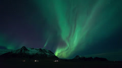 Aurora Borealis (Northern Lights) in Iceland with mountain timelapse Stock Footage