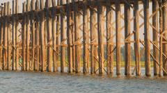 Pillars of the old wooden bridge. burma, mandalay, u bein bridge Stock Footage