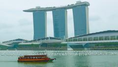 pleasure boat in the bay near marina bay. singapore - stock footage