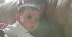 Baby laying on chest of Grandpa 4k Stock Footage