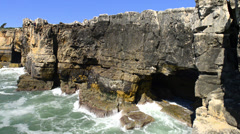 The rocky coastline of Cascais Stock Footage
