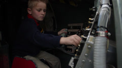 Ambitious boy tries his best inside the space capsule Stock Footage