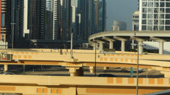 Time Lapse Traffic signs Dubai Sheikh Zayed road Metro train on elevated railway Stock Footage