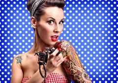Pin-up girl with tattoos - stock photo